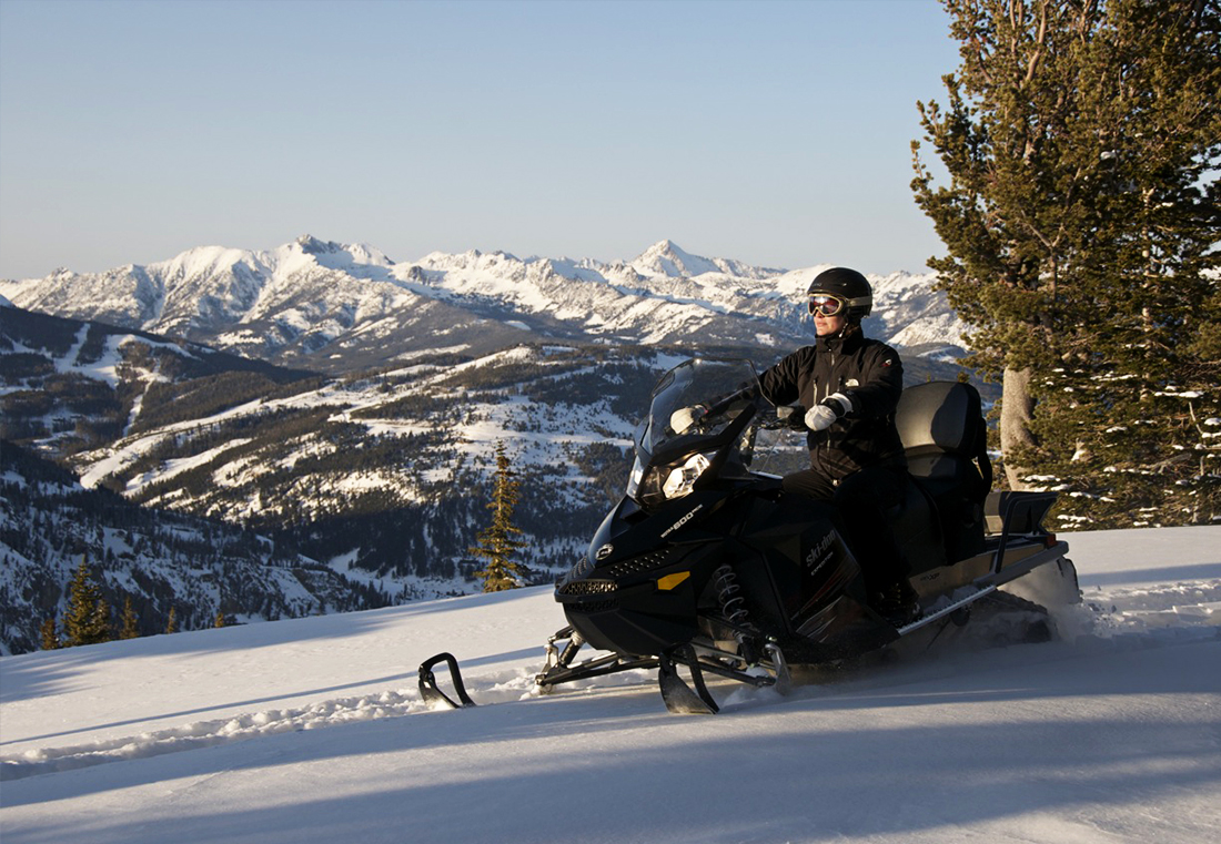 Experience a guided snowmobile tour Eglise Mountain.