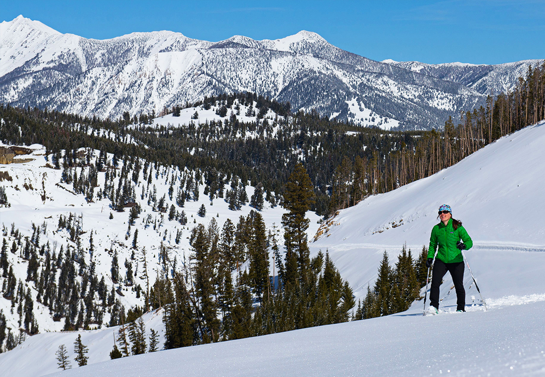 Enjoy Big Sky views during a guided snowshoe hike.